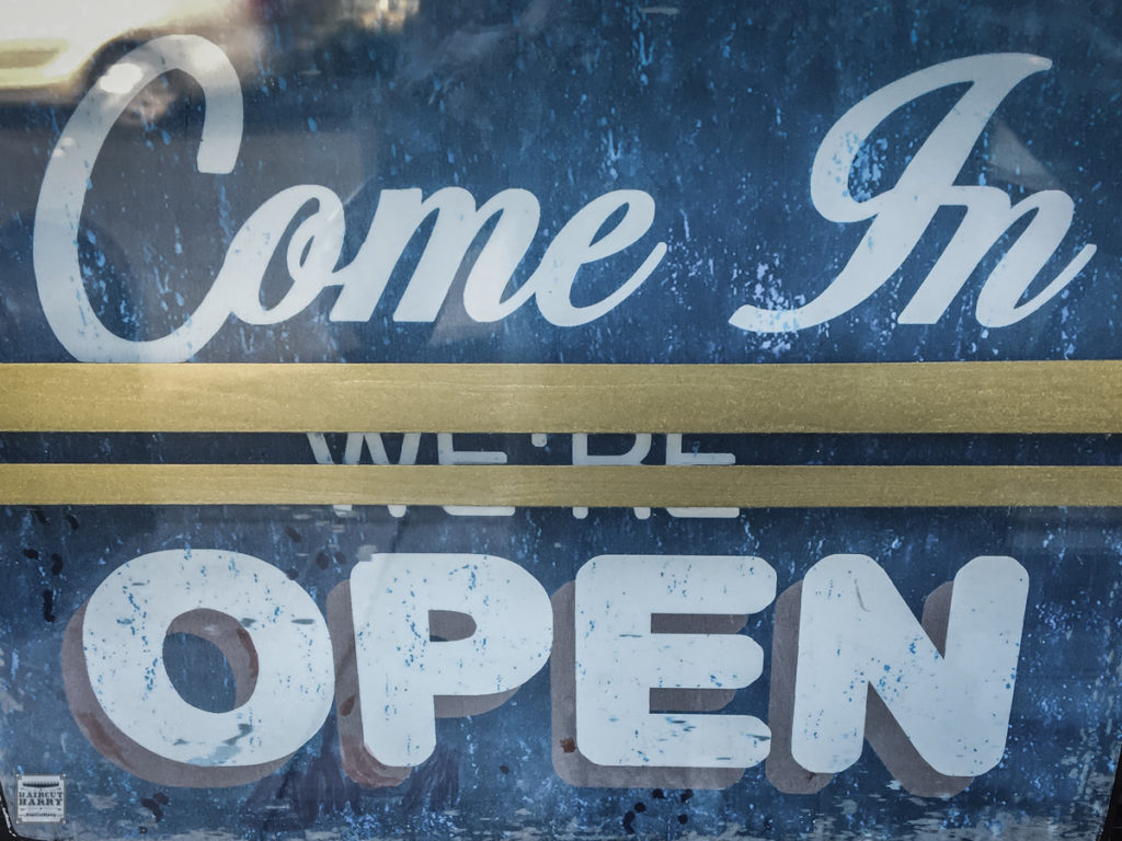 Open Sign In The Window Of Pappy's Barber Shop In San Diego