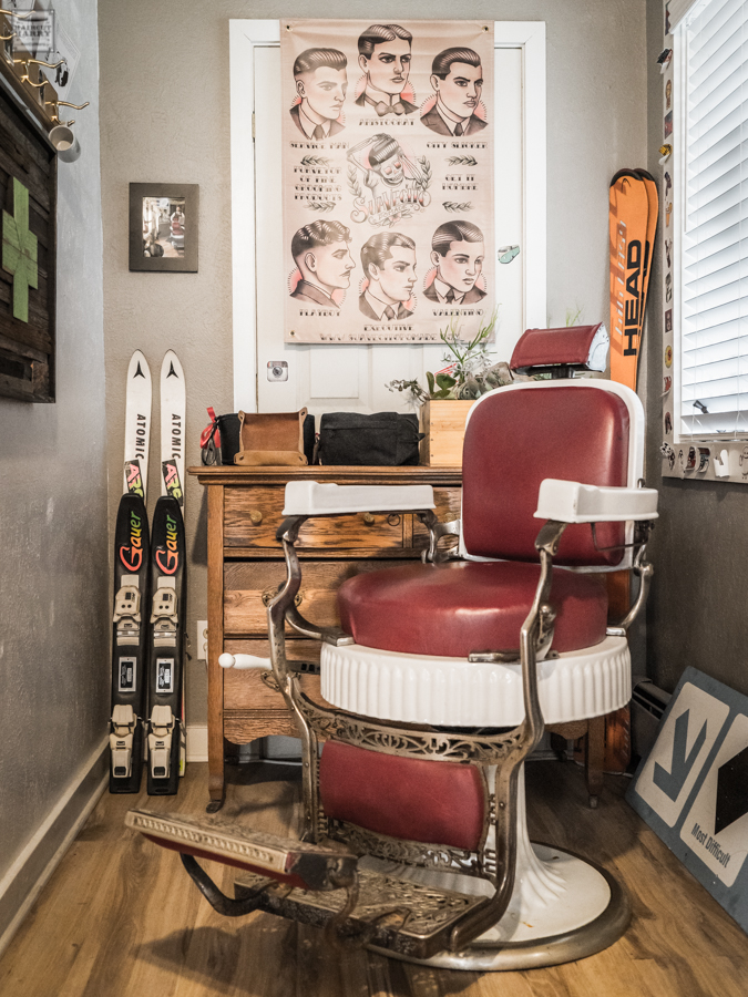 Barber chair and skis inside Steamboat Barbershop.