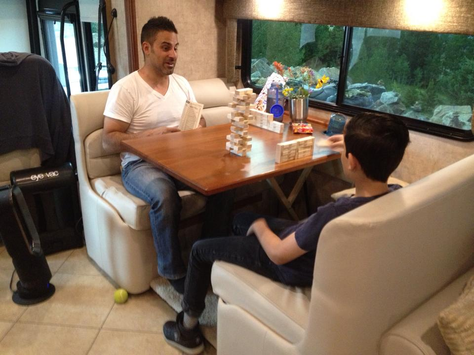 Joseph and John sitting at the table playing a game.