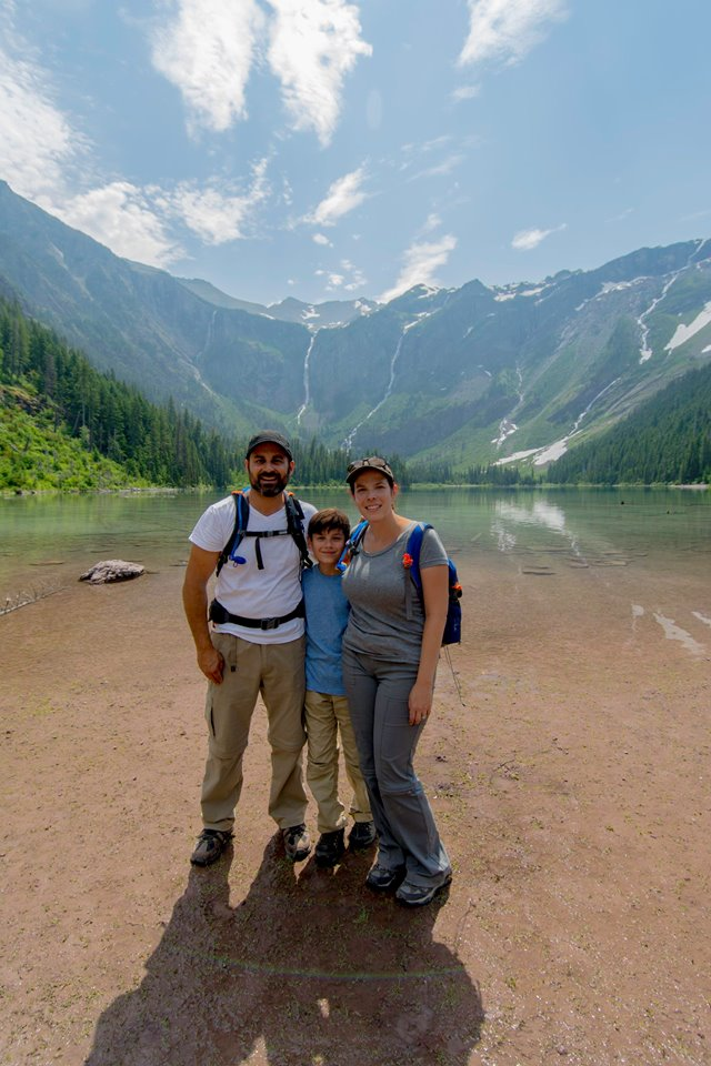 Family photo of John, Jennifer, and Joseph with the mountains in the background.