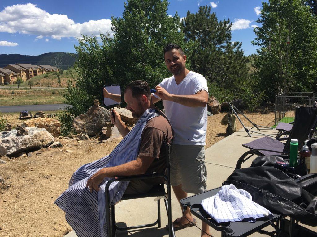 John giving a haircut outside.