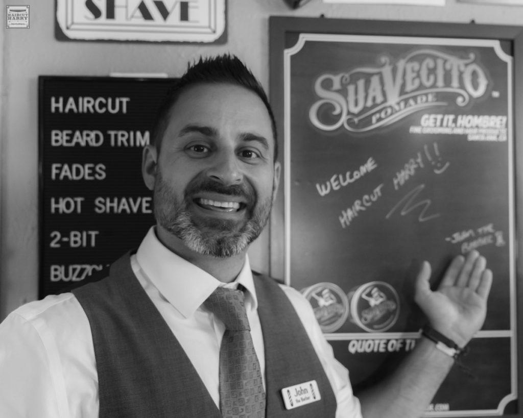 John welcoming Haircut Harry to Steamboat Barbershop.