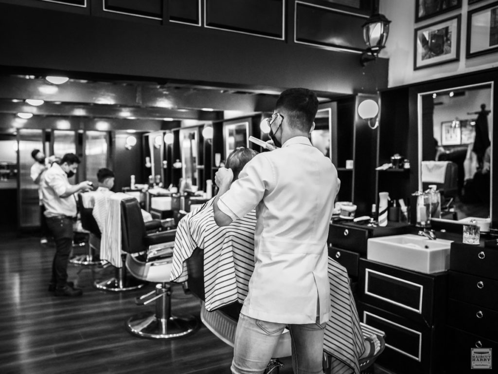 Barbers Working At Burman Barbershop