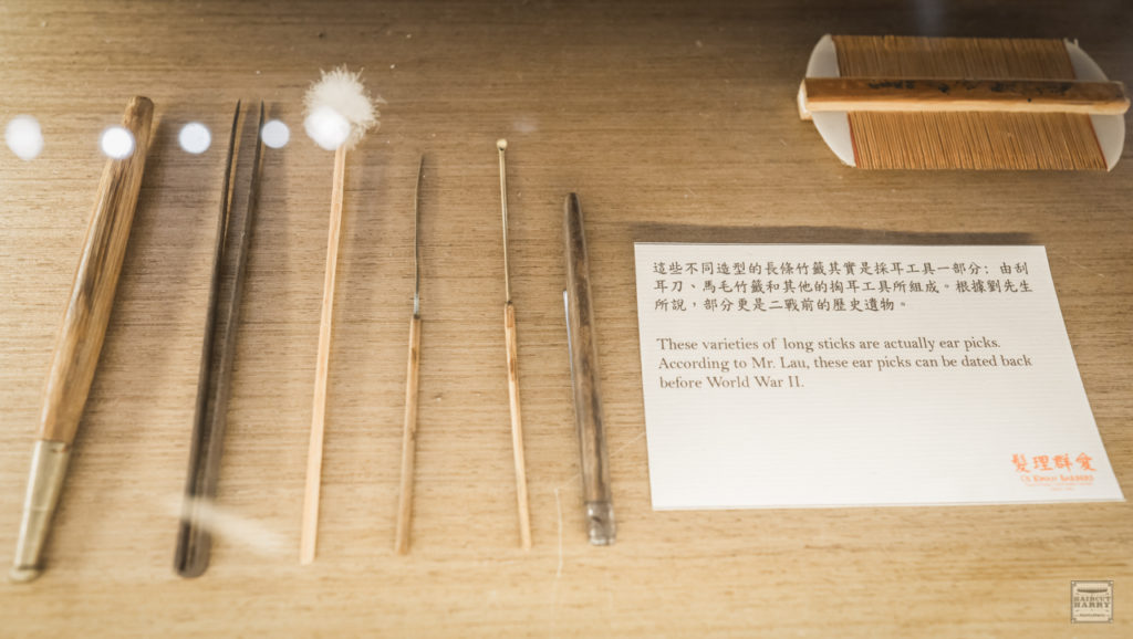 Master Lau's ear pick tools are on display inside the barbershop.  There is a sign that states, the tools date back to before WWII.