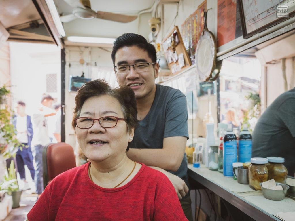 Mark and his mom inside the original Oi Kwan barbershop.