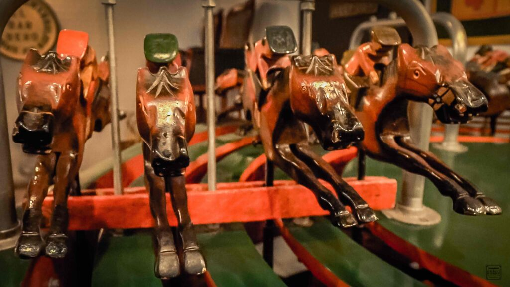 These vintage wooden horses spin around a track.  They are hand-carved out of coconut wood.