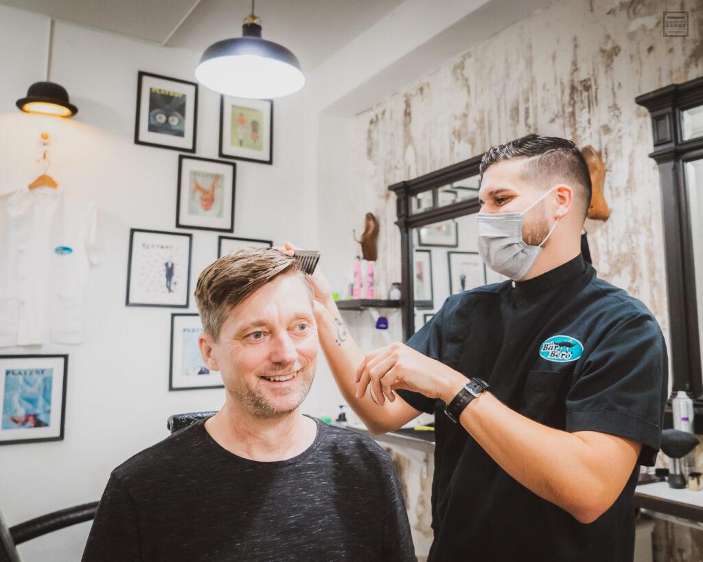 Haircut Harry getting a haircut at the attached barbershop at El Bar Bero.
