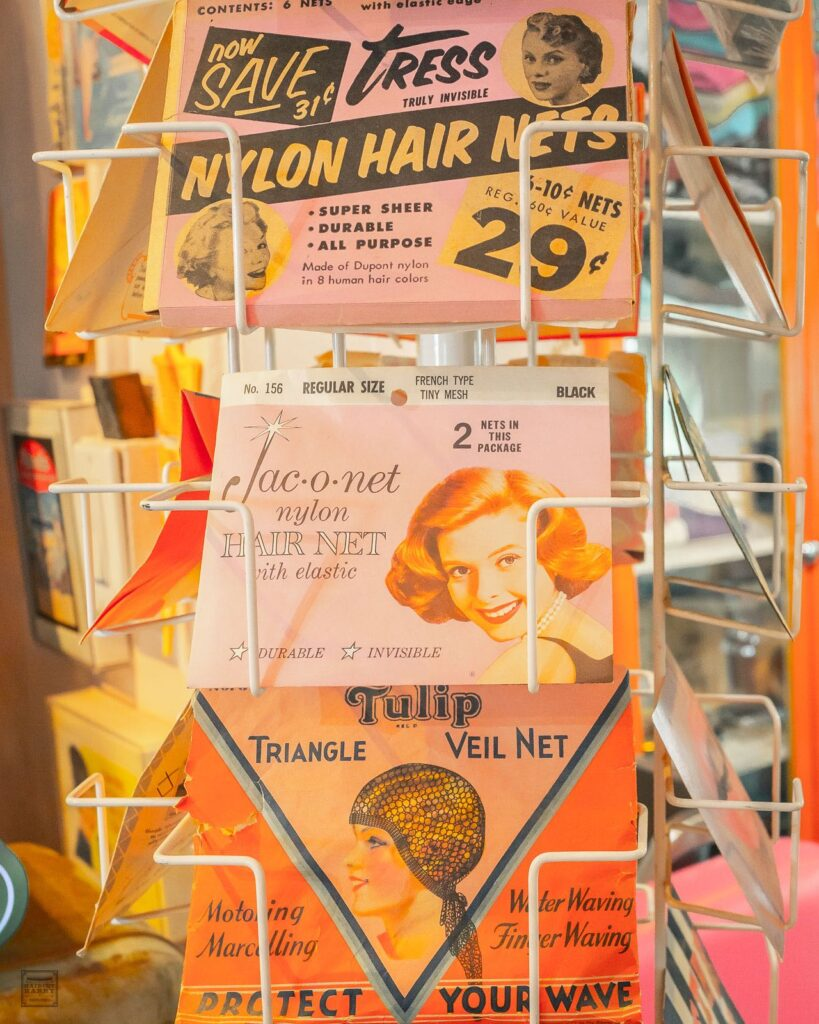 A display holding vintage hair nets in pastel colored packaging