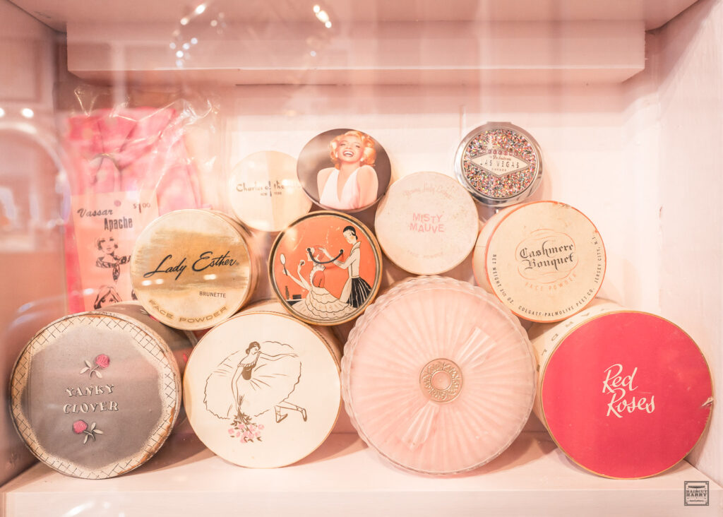 An assortment of round vintage powder boxes on display