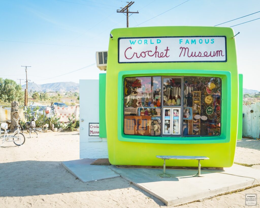 An old photo-processing booth houses the collection of the World Famous Crochet Museum in Joshua Tree, California
