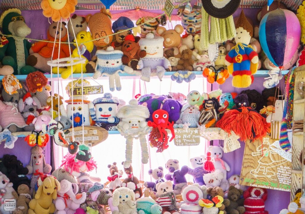 Colorful crochet animals displayed on shelves inside the Crochet Museum in Joshua Tree, California