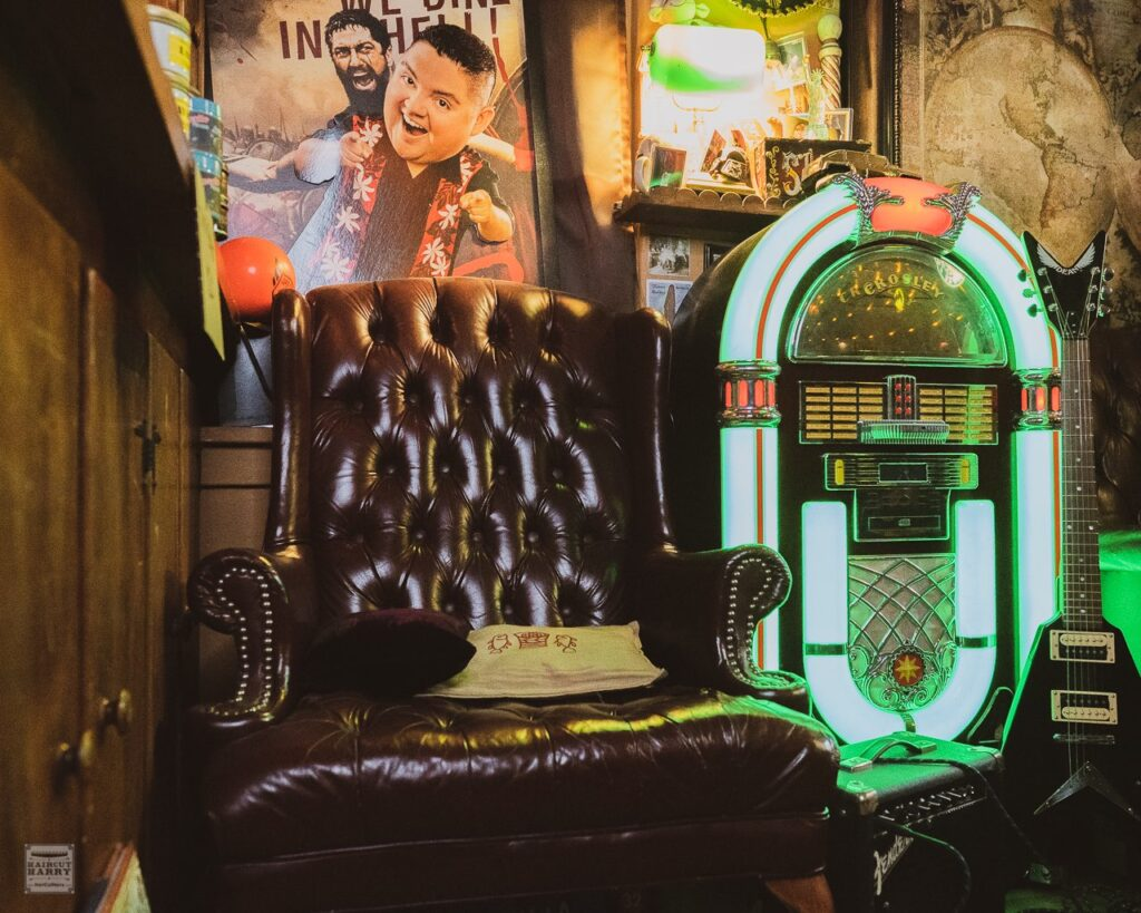 Inside Matt's Barber Parlor you'll find the neon lights of the juke box lighting up the space