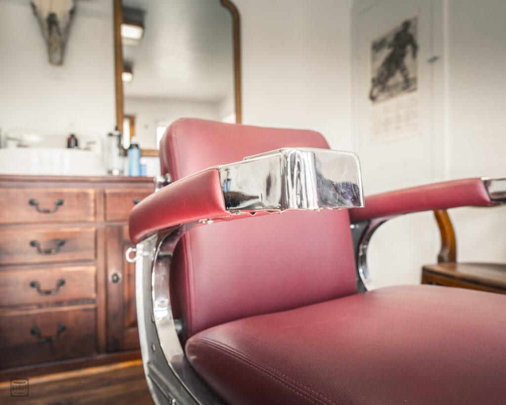Vintage Red Belmont Barber Chair Sits Inside Electric Barbering.