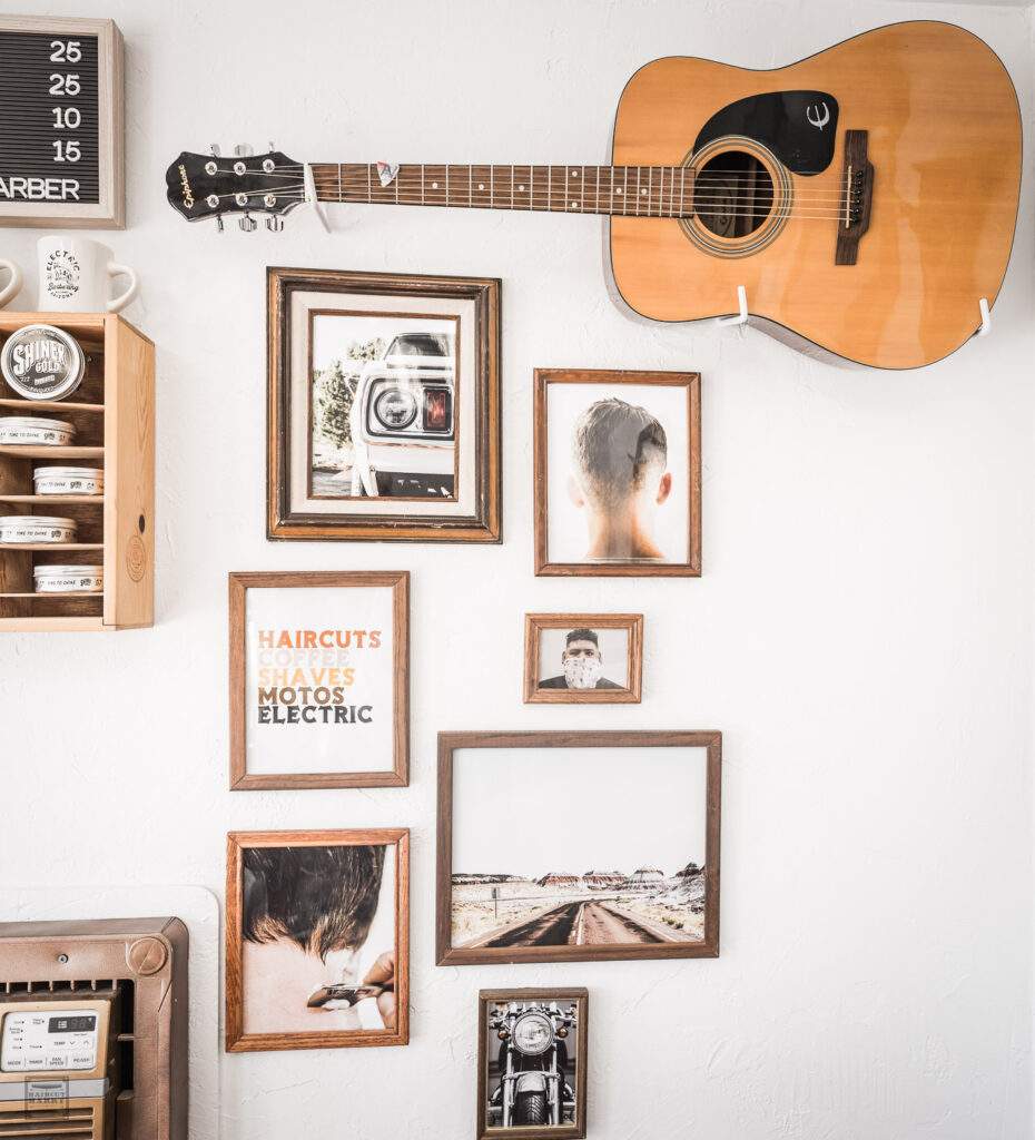 Calen's guitar hangs on the wall above a grouping of framed photographs he has taken.