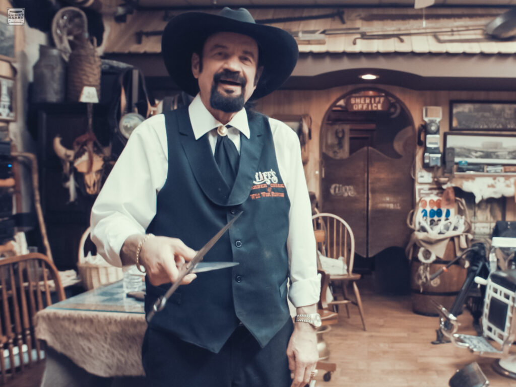 A portrait of Cliff inside Cliff's Barber Corral in Las Vegas, Nevada.  His western themed barbershop is like a little museum.