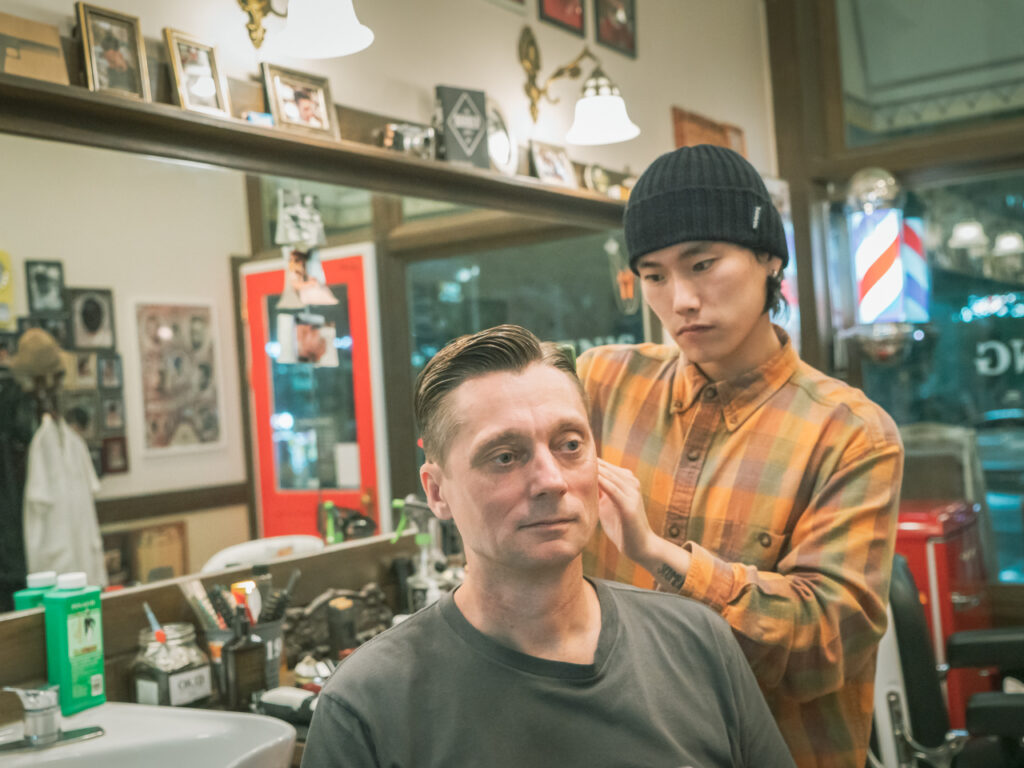 Haircut Harry getting a haircut at OKID Barbershop in Busan, South Korea